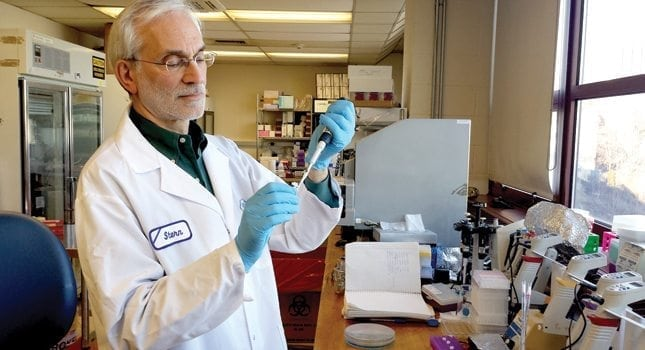Dr. Alvin Stern, director of the Biotechnology/Drug Discovery Laboratory in the Center for Healthcare Innovation at Stevens, transfers a compound to be tested for potency in an assay.