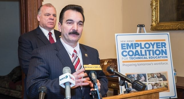Assembly Speaker Vincent Prieto discussed the benefits of career and vo-tech schools at the New Jersey Employer Coalition for Technical Education launch. Senate President Stephen Sweeney (background) talked about the severe shortage of skilled workers in the US.