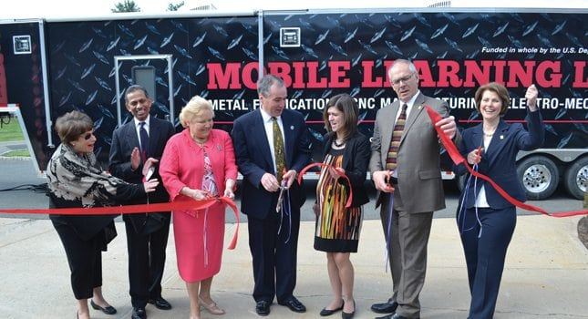 The ribbon cutting for the mobile manufacturing training classroom.