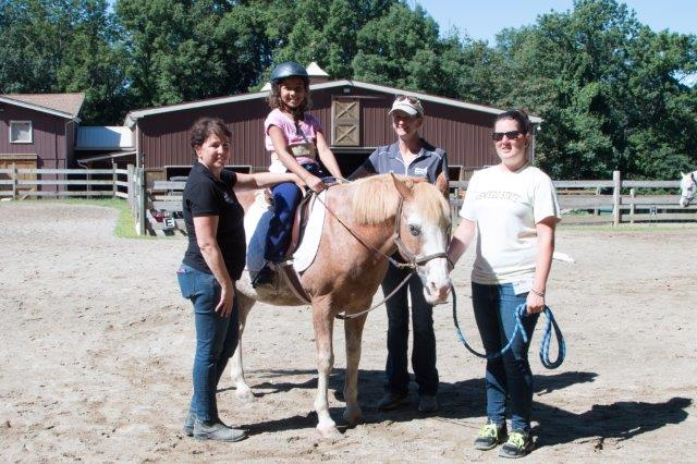 Dana Spett, founder and executive director of Pony Power; Gabriella Pereira, Pony Power participant; Jenn Caffrey, Pony Power instructor; Brianna Devine, Pony Power volunteer.