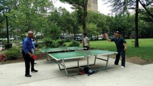 Newarkers enjoying a game of ping pong at Military Park. After many years as an underutilized space, Military Park now attracts children, adults, local residents, office workers and students to the city's revitalized town square.
