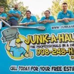 Owner Jeff Naeem (third from left) and his team with one of the Junk-A-Haulics trucks.